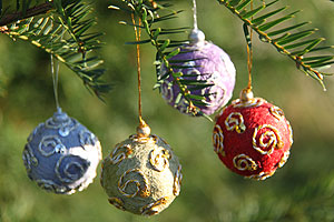 Four festive ball decorations   